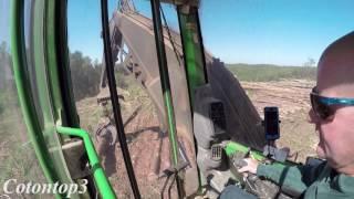 John Deere 2154d track loader loading a peterbilt log truck