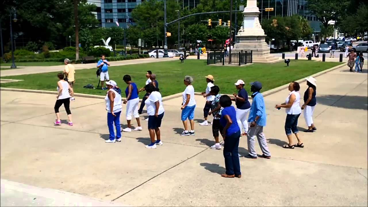 Soul Line Dancing Breaks Out Beneath Confederate Flag In Columbia, SC