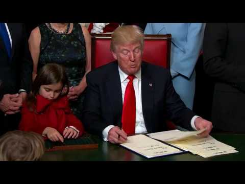 WATCH: FIRST DAY On The Job Donald Trump Signs New Laws