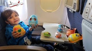 Zack airplane ride and opening surprise eggs toys! family fun trip