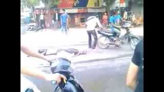 969 Buddhist Terrorists dragging Muslim man on the road in Meiktila Town