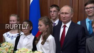 Russia: Putin gives eager teens an impromptu tour of his Kremlin office