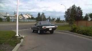 a 1972 ford gran torino car starting up and driving off from the meadowbrook husky edmonton