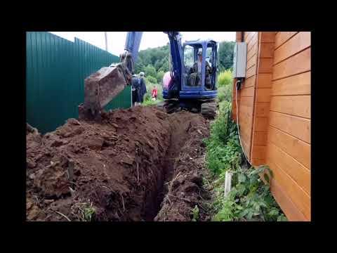 Канализация из колец//Копаем под водопровод//Экскаватор корчует многолетние корни
