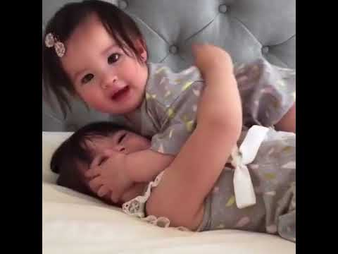 Precious Moment Between Baby Sisters