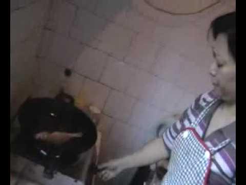 Kaifeng Jew preparing fish for Rosh Hashana