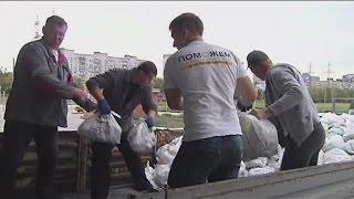 Переселенцы на юге Донецкой обасти получают гуманитарную помощь