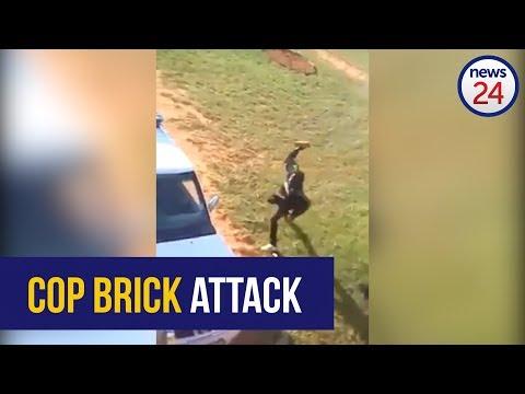 WATCH: Brick slinging man attacks cops