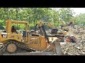 excavator dozer and dump truck moving dirt on road construction