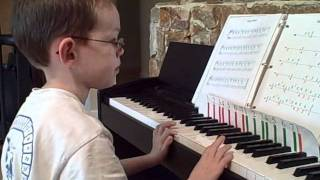 6 Yr old Autistic Kid Rocks on Piano Man Part 1