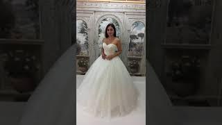 Свадебное платье из сверкающей ткани, пышное белого цвета