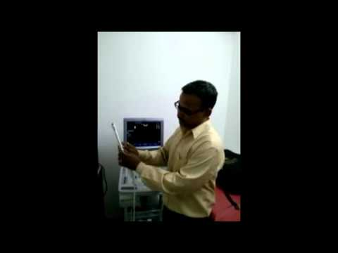 NUIPL Service Engineer explains the biopsy adaptor installation at customer site