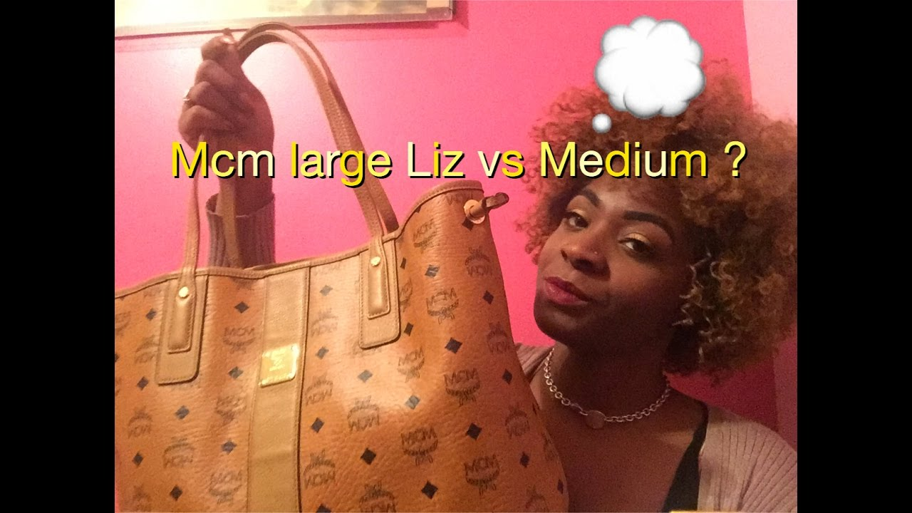 f29bc9e527b4 Mcm reversible Liz Large v.s medium - YouTube