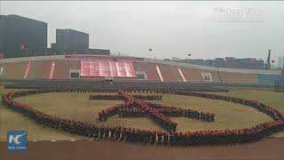 Grand 10,000-strong student military performance staged in SE China univ