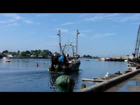 Fishing boats on the move. Gloucester Harbor. Gloucester, Massachusetts