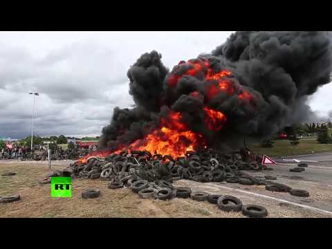 French farmers at it again: Block highways, burn tires over low prices