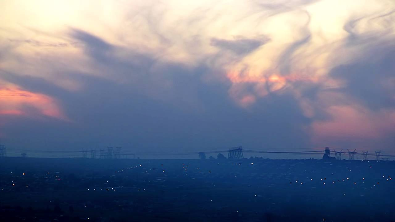 Stock: Sunset over South African township