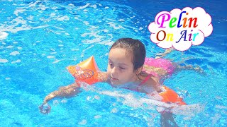 The big pool is so much fun with armbands, noodle and barbie swimming board!