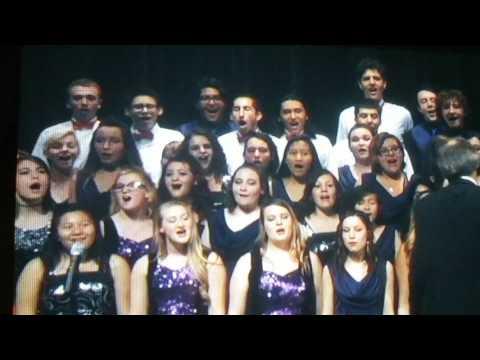 I lived sing by Arvada high school choirs
