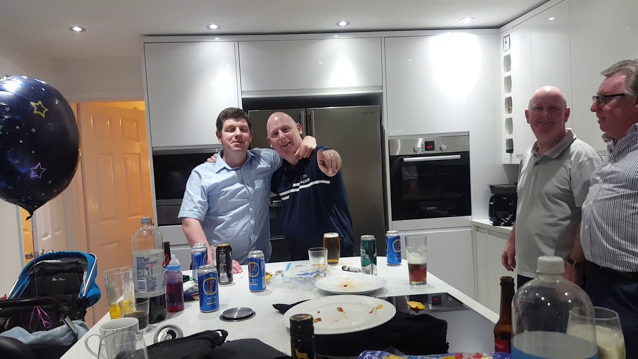 Uncle and nephew playing in the kitchen
