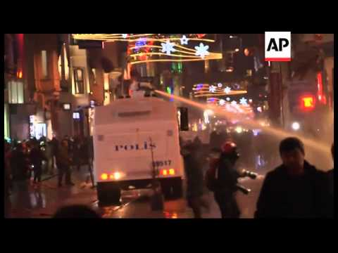 Turkey - Demonstrators in Taksim Square to protest allegations of corruption and bribery in governme