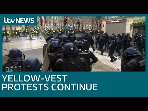 Water cannons and tear gas used to clear Champs-Elysees in Paris | ITV News