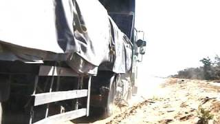 Samil 50s towing out a stuck truck in Botswana