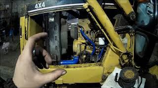 экскаватор - погрузчик CAT428B, установка элетроподогревателя, замена антифриза и другой ремонт)))