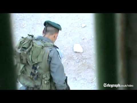 Israeli Policeman Filmed Kicking Palestinian Boy In Hebron