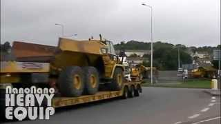 Six VOLVO Heavy Haulage Truck Transporting 6 Cat 730 Articulated Truck through Highway