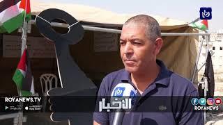 ناشطو المقاومة الشعبية ينصبون خيمة تحت اسم بوابة القدس بين العيزرية وأبو ديس - (4-10-2018)
