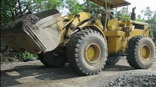 Old Wheel Loader Loading Stone Crusher