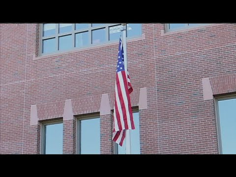 Holyoke Police Department hangs new flag honoring late officer