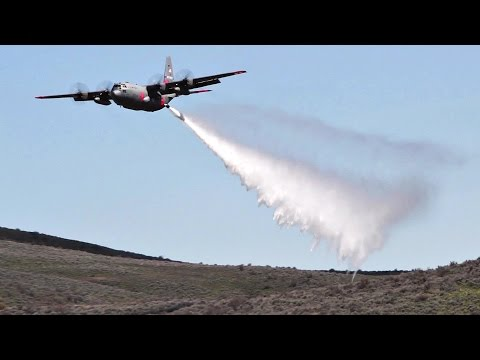 C-130 Military Firefighting Aircraft Dump Thousands Of Gallons Of Water Onto Firefighting Targets