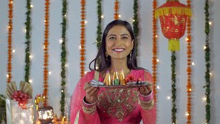 Attractive Indian woman happily smiling and showing crackers to the camera - Diwali festival