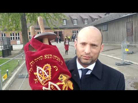 Education and Diaspora Minister of Israel with Torah scroll in Auschwitz
