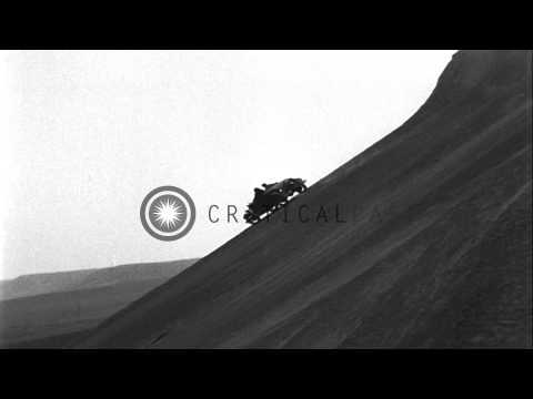 Several cars climb the steep hills at Colorado Springs HD Stock Footage