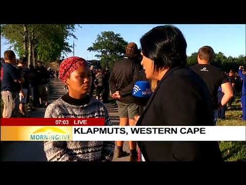 Protesters gather for a march against farm murders