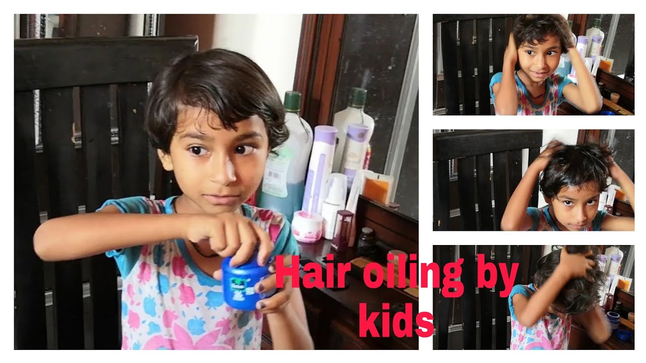 Hair oiling, head massage by little girl (hair oiling by kids)