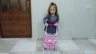 Королевская коляска для куклы Baby Born / . СЕСТРА ИГРАЕТ В КУКЛЫ!!!АРАМ ЗАМ ЗАМ - Песни Для Детей.