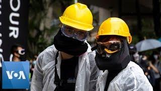 Hong Kong Protestors Wear Face…