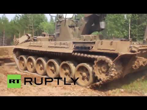 Russia: Army mine clearance vehicles battle wildfires in Irkutsk Region