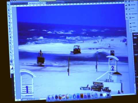 BP covers oil with sand on Gulf Shores Beach as the Coast Guard looks on
