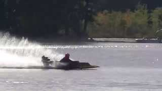 Christine Brewster racing her hydroplane with the American Power Boat Association