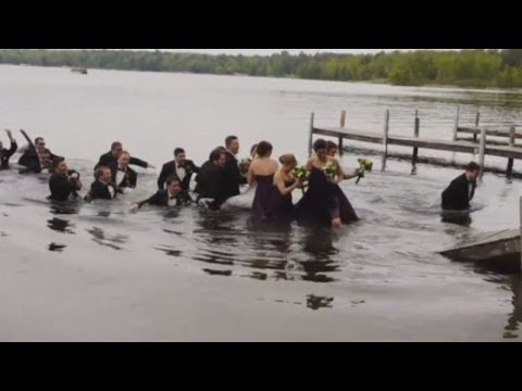 WATCH: Wedding party falls into lake when dock collapses