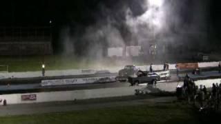 Grey truck vs Mike Henson