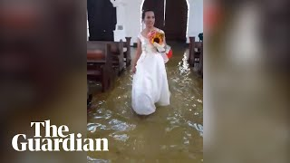 Bride wades up the aisle during Philippines flood