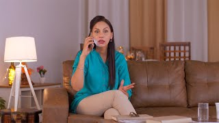 Mid age Indian woman talking on the phone. Shocked, Angry, Surprised expression