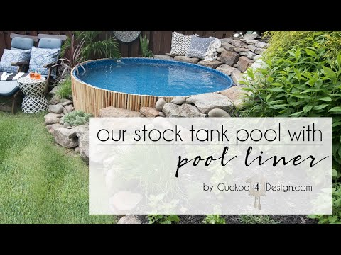 stock tank swimming pool in our sloped yard