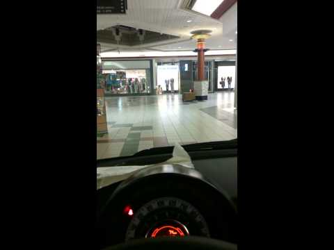 Driving a Fiat 500 through shopping mall